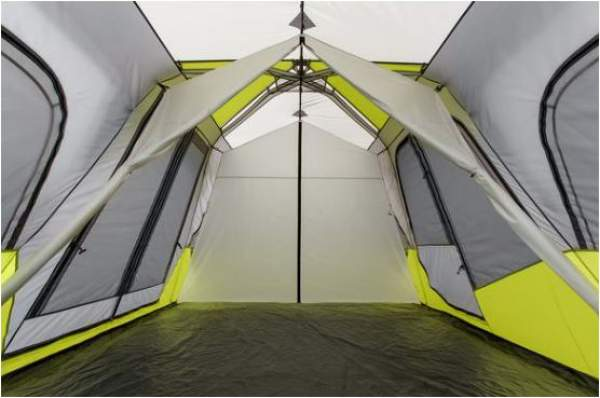 The view along the tent interior, with the dividers rolled to the sides.