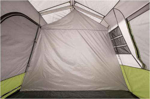 Here is the tent with the divider in place. Each room is with its own entry door, and with its own storage area on the wall.