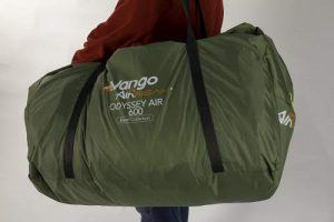 The tent is portable in its oversized bag.