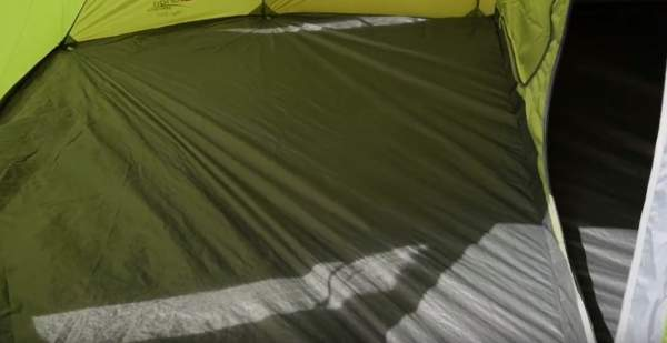 The floor is sewn-in to the inner tent (on the right) and linked-in to the shell tent around the perimeter.