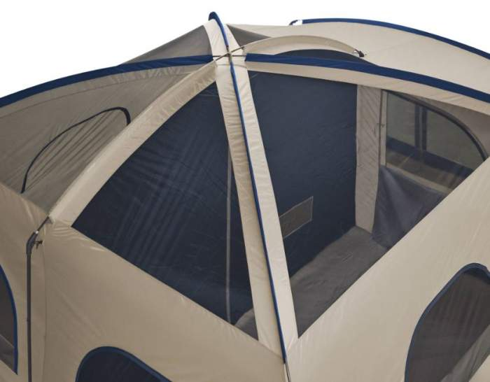 The roof structure with mesh and fiberglass poles.
